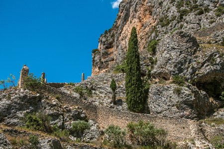 View of the way to the Notre-Dame de Beauvoir church going up the rock, above the graceful Moustiers-Sainte-Marie village. Alpes-de-Haute-Provence department, Provence region, southeastern France