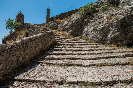View of the staircase to the Notre-Dame de Beauvoir church, above the graceful Moustiers-Sainte-Marie village. Alpes-de-Haute-Provence department, Provence region, southeastern France