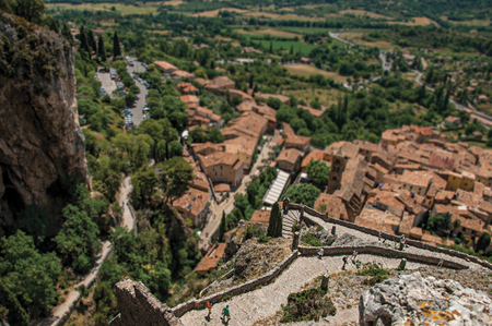 View of stone staircase, roofs and belfry in the charming village of Moustiers-Sainte-Marie. In the Alpes-de-Haute-Provence department, Provence region, southeastern France. Retouched photo Imagens