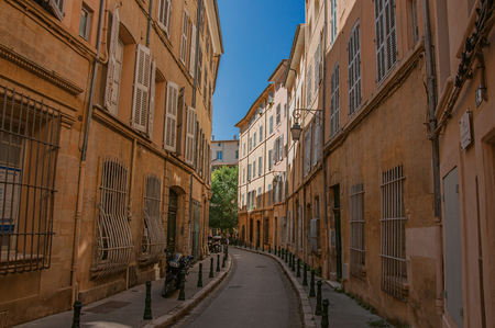 Aix-en-Provence, France - July 09, 2016. Narrow alley with buildings in the shadow in Aix-en-Provence, a pleasant and lively town in the countryside. Provence region, southeastern France Editorial