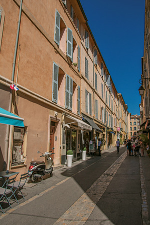 Aix-en-Provence, France - July 09, 2016. Alley with people and blue sky in Aix-en-Provence, a lively town in the French countryside. Bouches-du-Rhone department, Provence region, southeastern France Editorial