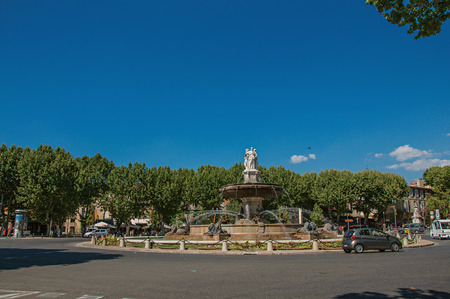 Aix-en-Provence, France - July 09, 2016. Panoramic view of roundabout, fountain and cars in Aix-en-Provence, a pleasant and lively town in the French countryside. Provence region, southeastern France