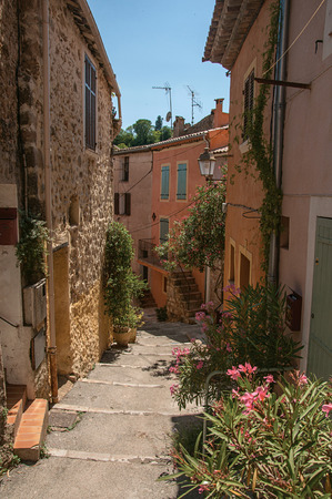 View of stone houses in alley on the slope under blue sky, at the gorgeous medieval hamlet of Les Arcs-sur-Argens, near Draguignan. Located in the Provence region, Var department, southeastern France Reklamní fotografie