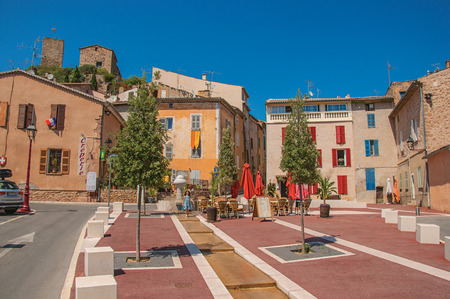 Les Arcs-sur-Argens, France - July 10, 2016. Square view with little girl walking, at the gorgeous medieval hamlet of Les Arcs-sur-Argens. In the Provence region, Var department, southeastern France