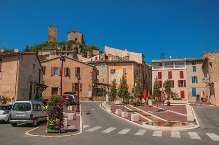 Les Arcs-sur-Argens, France - July 10, 2016. View of square with houses and ancient town on the hill, at the gorgeous medieval hamlet of Les Arcs-sur-Argens, near Draguignan. Located in the Provence region, Var department, southeastern France