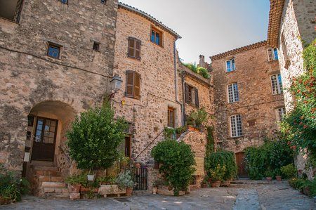 View of old stone houses in alley under shadow, at the gorgeous medieval hamlet of Les Arcs-sur-Argens, near Draguignan. Located in the Provence region, Var department, southeastern France Imagens