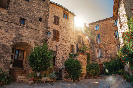 View of old stone houses in alley under shadow, at the gorgeous medieval hamlet of Les Arcs-sur-Argens. Located in the Provence region, Var department, southeastern France. Retouched photo