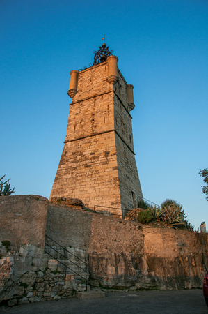 View of the clock tower made of stone and with a bell, stands on top of the hill dominating the whole gracious city of Draguignan. Located in the Provence region, Var department, southeastern France Banque d'images - 94859298