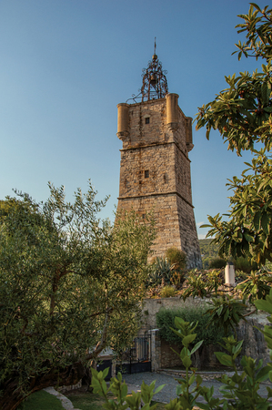 View of the clock tower made of stone on top of the hill with vegetation in the lively and gracious town of Draguignan. Located in the Var department, Provence region, southeastern France Banque d'images