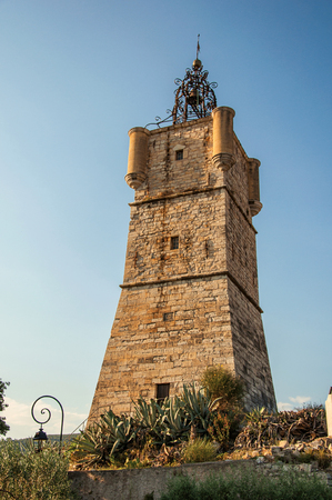 View of the clock tower made of stone on top of the hill with vegetation in the lively and gracious town of Draguignan. Located in the Var department, Provence region, southeastern France Banque d'images - 94878037