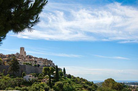 Panoramic view of the village of Saint-Paul-de-Vence on top of hill, a beautiful well preserved medieval hamlet near Nice. Located in the Alpes-Maritimes department, Provence region, southeastern France