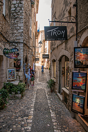 Saint-Paul-de-Vence, France - July 13, 2016. View of stone street with shop in the village of Saint-Paul-de-Vence, stunning medieval town completely preserved. In Provence region, southeastern France
