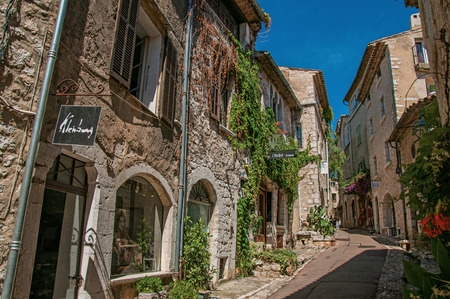 Saint-Paul-de-Vence, France - July 13, 2016. Alley with stone houses and shops in the Saint-Paul-de-Vence village, stunning medieval town completely preserved. In Provence region, southeastern France