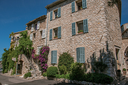 Saint-Paul-de-Vence, France - July 13, 2016. House with staircase and bindweed in the Saint-Paul-de-Vence village, stunning medieval town completely preserved. In Provence region, southeastern France 에디토리얼