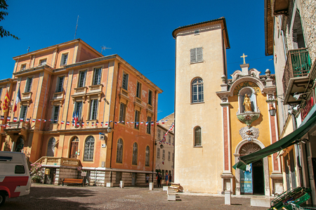 Vence, France - July 13, 2016. View of the city hall's church and building in Vence, a stunning medieval town completely preserved. In Alpes-Maritimes department, Provence region, southeastern France