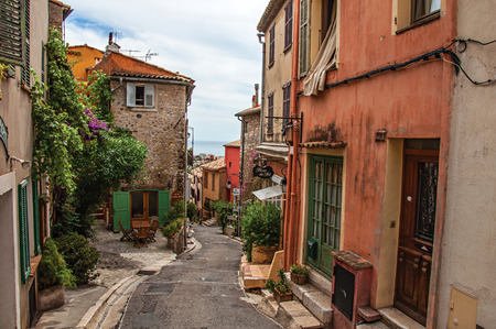 Haut-de-Cagnes, France - July 14, 2016. View of alley with houses in Haut-de-Cagnes, a pleasant village on top of a hill, near Nice. In Alpes-Maritimes department, Provence region, southeastern France
