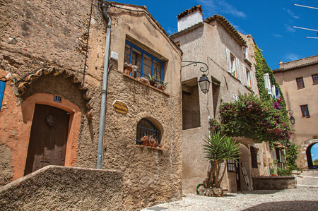 Haut-de-Cagnes, France - July 14, 2016. View of alley with houses and flowered creeper in Haut-de-Cagnes, a pleasant village on top of a hill. In Alpes-Maritimes department, Provence region Editorial
