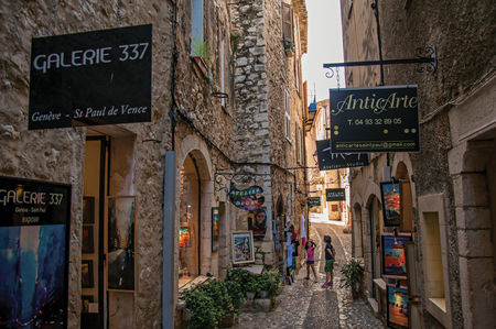 Saint-Paul-de-Vence, France - July 13, 2016. View of stone street with shop in the village of Saint-Paul-de-Vence, stunning medieval town completely preserved. In Provence region, southeastern France Editorial