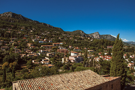Panoramic view of hills and rooftops outside of city center of Vence, a stunning medieval hamlet completely preserved. Located in the Alpes-Maritimes department, Provence region, southeastern France