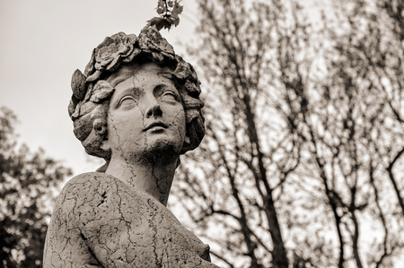 Como, Italy - May 06, 2013. Close-up of female face sculpt in marble in a cloudy gloomy day on the Lake of Como. A pleasant town a few miles from Milan. In the Lombardy region, northern Italy. Editorial