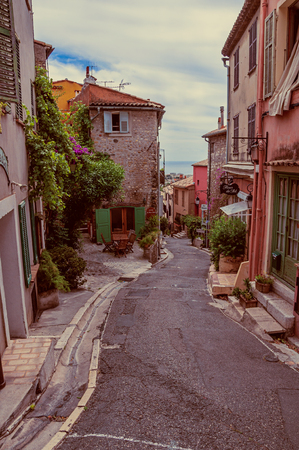 Haut-de-Cagnes, France - July 14, 2016. View of alley with houses in Haut-de-Cagnes, a pleasant village on top of a hill, near Nice. In Provence region, southeastern France. Retouched photo