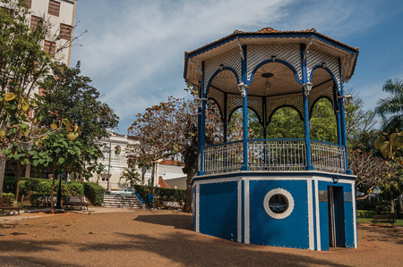 Sao Manuel, southeast Brazil - September 09, 2017. Colorful gazebo in a small square amid verdant garden, in a sunny day at San Manuel. A cute little town in the countryside of São Paulo State. Stock Photo