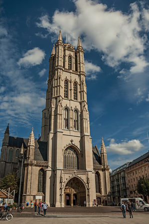 Ghent, Belgium - July 03, 2017. People, Gothic cathedral and blue cloudy sky in Ghent. In addition to intense cultural life, the city is full of Gothic and Flemish style buildings. Northern Belgium. Editorial