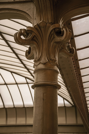 Detail of cast-iron capital in Art Nouveau style and glass ceiling in Brussels. Vibrant and friendly, is the countrys capital and administrative center of the EU. Central Belgium. Stock Photo