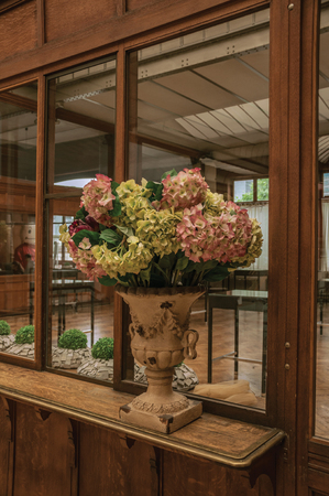 Brussels, Central Belgium - July 04, 2017. Vase decorated with flowers on shelf in an old building, at Brussels. Vibrant and friendly, is the countrys capital and administrative center of the EU. Editorial