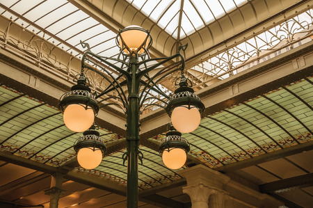 Brussels, Central Belgium - July 04, 2017. Art Nouveau lamp and glass ceiling in an old building, at Brussels. Vibrant and friendly, is the countrys capital and administrative center of the EU. Editorial