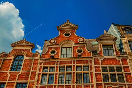Facade with bricks and window adorned in the region of Flanders style in Brussels. Vibrant and friendly, is the country's capital and administrative center of the EU. Central Belgium. Retouched photo