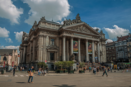Brussels, Belgium - July 04, 2017. People in front of the Brussels Stock Exchange building. Vibrant and friendly, is the countrys capital and administrative center of the EU. Central Belgium.