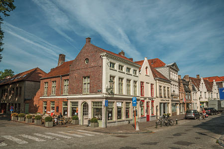 Bruges, Belgium - July 05, 2017. Street with brick houses at early morning in Bruges. With many canals and old buildings, this graceful town is a World Heritage Site of Unesco. Northwestern Belgium.