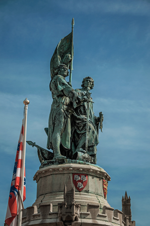 The statues of Jan Breydel and Pieter de Coninck at the Market Square of Bruges. With many canals and old buildings