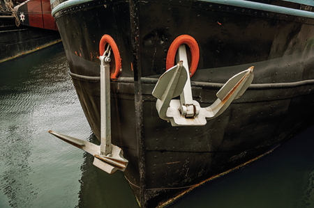 Close-up of a rusty boat moored in port at Amsterdam. Famous for its huge cultural activity, graceful canals and bridges. Northern Netherlands. Editorial