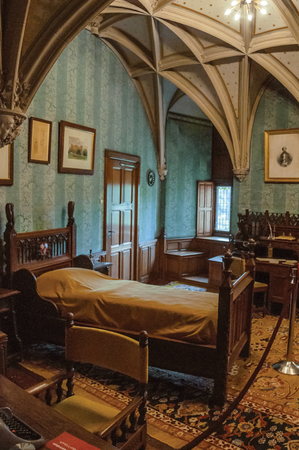 Furniture in luxurious De Haar Castle bedroom, near Utrecht. Of medieval origin, it underwent reforms until assuming a richly decorated Gothic style.