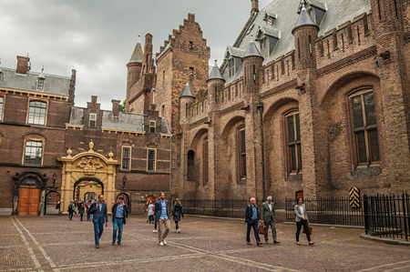People in the Binnenhof (Gothic public buildings) inner courtyard at The Hague. Important political center, is a mix of historic city with modernity.