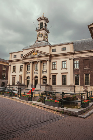 Square with the Neoclassical facade of the City Hall's building in a cloudy day at Dordrecht. Important and historic port city bordered by rivers.