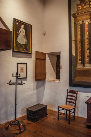 Ammersoyen, southern Netherlands - July 01, 2017. Interior view of a room in the medieval Ammersoyen Castle with furniture and old pictures. Near to the historic and vibrant city of s-Hertogenbosch.