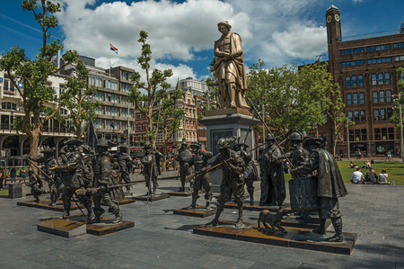 Amsterdam, northern Netherlands - June 26, 2017. Rembrandt Square with sculptural reproduction in bronze from the Night Watch picture. Famous for its huge cultural activity, graceful canals and bridges.