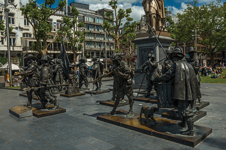 Amsterdam, northern Netherlands - June 26, 2017. Rembrandt Square with sculptural reproduction in bronze from the Night Watch picture. Famous for its huge cultural activity, graceful canals and bridges. Editorial