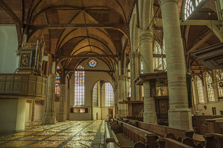 Amsterdam, northern Netherlands - June 27, 2017. Internal view of gothic church with artistic interference in Amsterdam. Famous for its huge cultural activity, graceful canals and bridges. Editorial