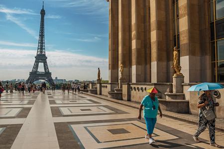 """Paris, France - July 07, 2017. People at the Trocadero and Eiffel Tower in Paris. Known as the """"City of Light"""", it is one of the most impressive cultural centers in the world. Northern France."""
