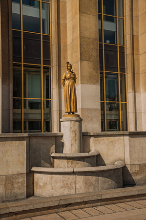 Paris, northern France - July 07, 2017. Statue of golden woman and dove in front of building at Trocadero in Paris. Known as one of the world's most impressive cultural centers.