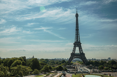 Seine River, Eiffel Tower and gardens under sunny blue sky, seen from the Trocadero in Paris. Known as the