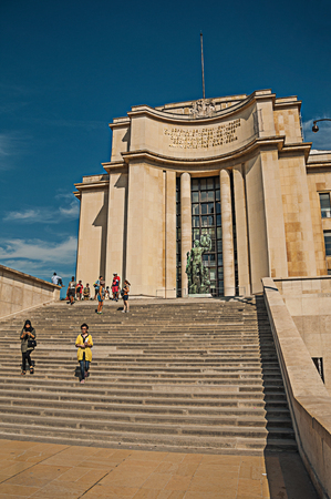 """Paris, France - July 07, 2017. People, building and staircase at the Trocadero in Paris. Known as the """"City of Light"""", it is one of the most impressive cultural centers in the world. Northern France"""
