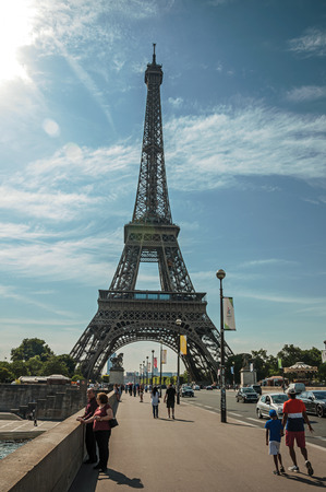 Paris, France - July 07, 2017. People and Eiffel Tower with blue sky and sunshine in Paris. Known as the