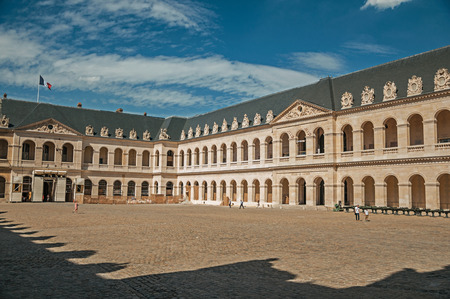 View of the inner courtyard of the Les Invalides Palace with old cannons in a sunny day at Paris. Known as the City of Light, it is one of the most impressive cultural centers in the world. Northern France.