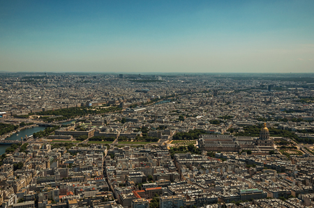 Skyline, buildings and Les Invalides dome in a sunny day, seen from the Eiffel Tower top in Paris. Known as the