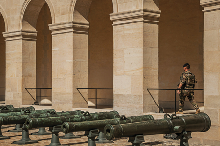 """Paris, France - July 07, 2017. Guard soldier in the inner courtyard of the Les Invalides at Paris. Known as the """"City of Light"""", it is one of the world's most awesome cultural centers. Northern France."""